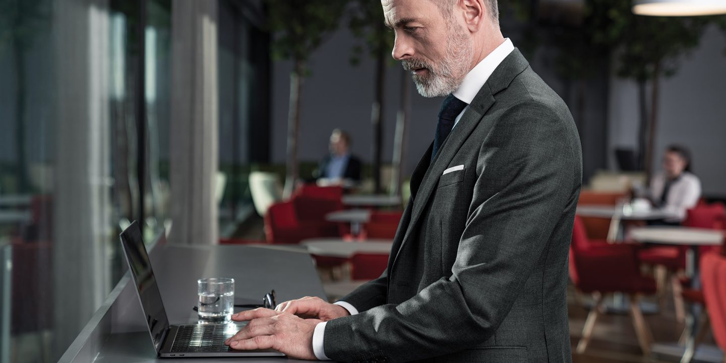 Businessman using laptop in Austrian lounge